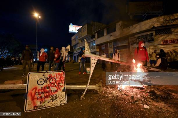 Demostrators block a street with a barricade in Cali, Colombia, on May 2 during a protest against a tax reform bill launched by President Ivan Duque....