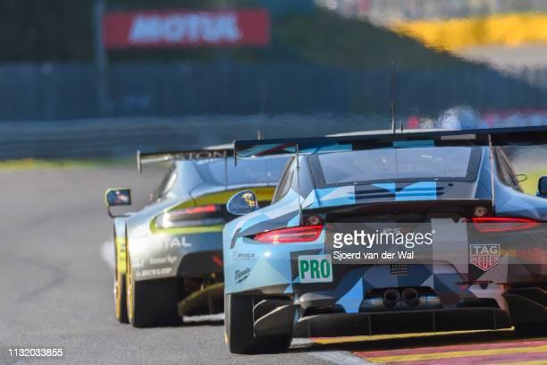 Dempsey Proton Racing Porsche 911 RSR driven by R LIETZ / M CHRISTENSEN chasing an Aston Martin Racing Aston Martin V8 Vantage on track during the 6...