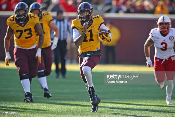 Demry Croft of the Minnesota Golden Gophers carries the ball for 27 yards setting up a touchdown in the fourth quarter against the Minnesota Golden...