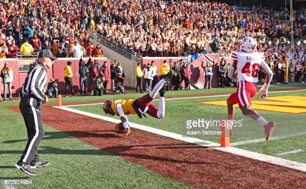 Demry Croft of the Minnesota Golden Gophers gets pushed out of bounds by Joshua Kalu in the fourth quarter at TCF Bank Stadium on November 11 2017 in...