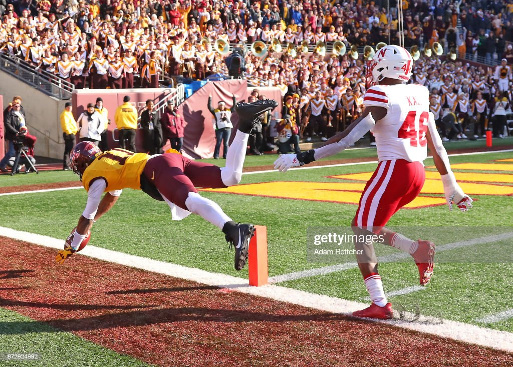 Demry Croft #11 of the Minnesota Golden Gophers gets pushed out of bounds by Joshua Kalu in the fourth quarter at TCF Bank Stadium on November 11, 2017 in Minneapolis, Minnesota. Minnesota defeated Nebraska 54-21.