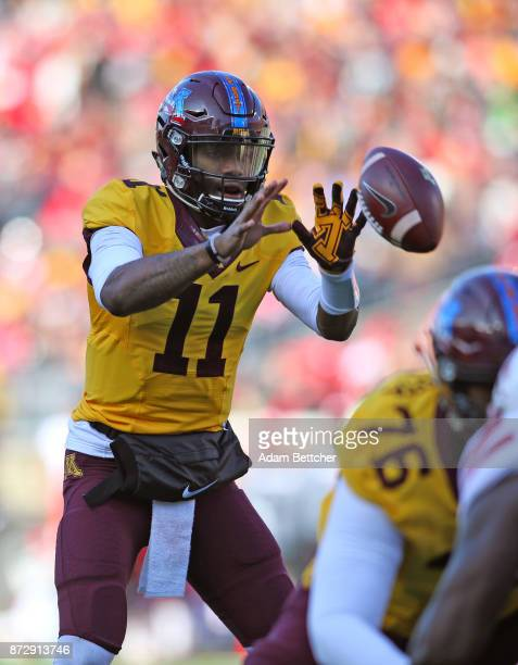 Demry Croft of the Minnesota Golden Gophers takes the snap in the first quarter against the Nebraska Cornhuskers at TCF Bank Stadium on November 11...