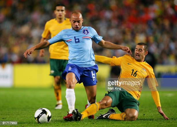 Demy de Zeeuw of the Netherlands is tackled by Carl Valeri of the Socceroos during the International friendly football match between Australia and...