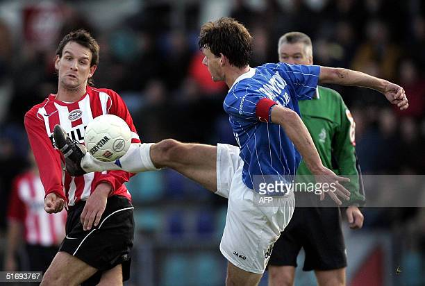 Den Bosch's Peter Unekenduels fights for the ball with PSV Eindoven's Jan Vennegoor during their Dutch Premier League match in Den Bosch the...
