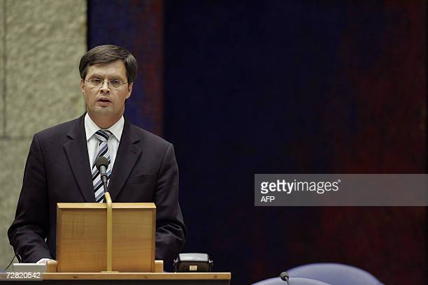 Dutch Prime Minister Jan Peter Balkenende speaks to the parliament after a long crisis council meeting with the cabinet in The Hague 13 December 2006...
