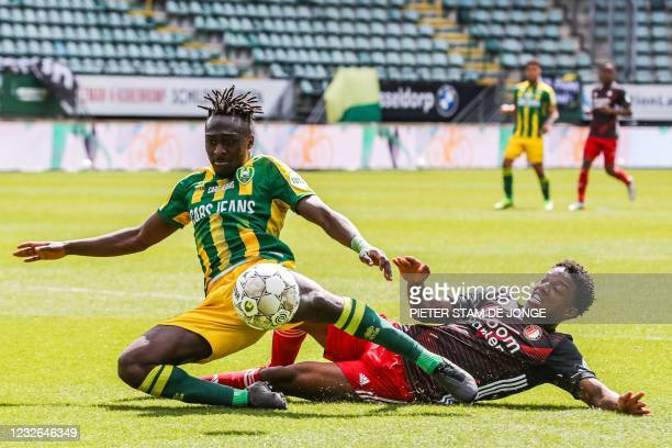 Den Haag Nigerian forward Bobby Adekanye fights for the ball against Feyenoord's Dutch defender Tyrell Malacia during the Dutch Eredivisie match...
