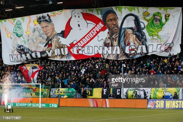Den Haag trainer / coach Alan Pardew, ADO Den Haag assistant trainer Chris Powell on big banner of ADO fans. Ghostbusters during the Dutch Eredivisie...