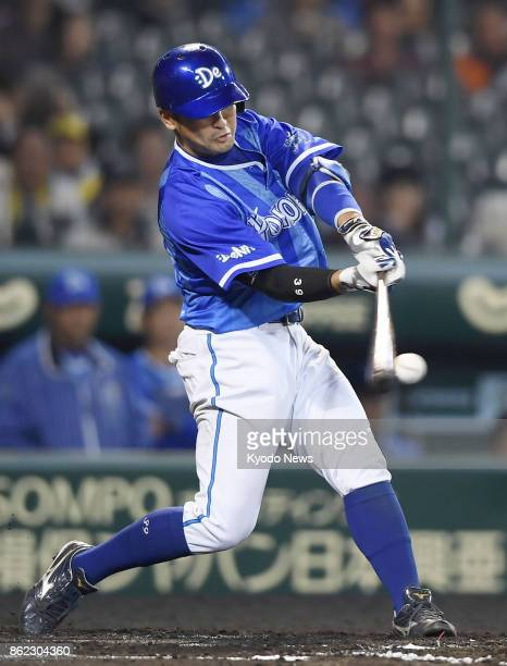 DeNA BayStars' Hiroki Minei hits a tworun single to left in the first inning of Game 3 of the Central League Climax Series against the Hanshin Tigers...