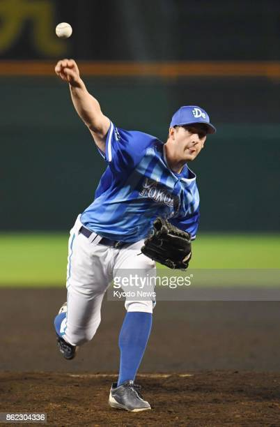 DeNA BayStars starting pitcher Joe Wieland throws against the Hanshin Tigers in Game 3 of the Central League Climax Series against at Koshien Stadium...