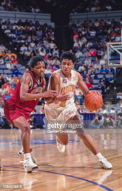 Dena Head, Guard for the Tennessee Lady Volunteers dribbles the basketball downcourt as Sonja Henning, Guard for the University of Stanford Cardinal...