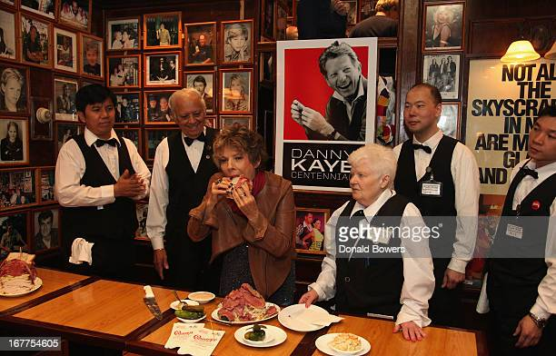 Dena Kaye cuts the first Danny Kaye Deli Club to commemorate Danny Kaye's Centennial at the Carnegie Deli on April 29 2013 in New York City