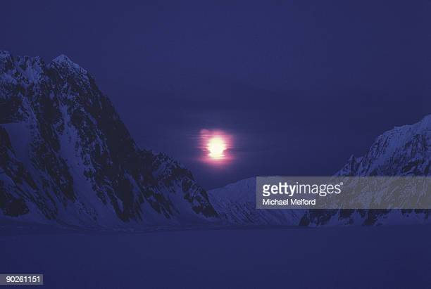 the moon above ruth glacier. - snow moon stock pictures, royalty-free photos & images