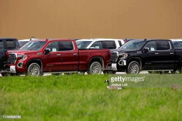 Denali pickup trucks sit in a parking lot outside the GM Fort Wayne Assembly Plant on May 30, 2019 in Roanoke, Indiana. General Motors Chairman and...