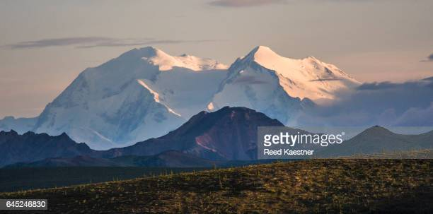 Denali, the highest mountain in North America bathed in late evening light.