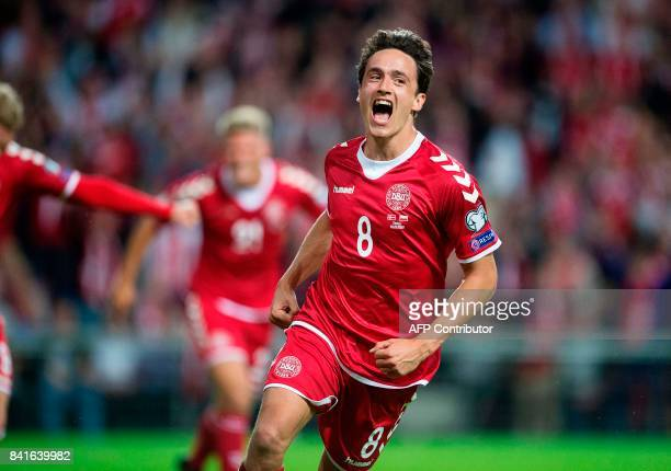Denamrk's Thomas Delaney celebrates after scoring the 10 during the FIFA World Cup 2018 qualification football match between Denmark and Poland in...