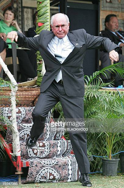 Australian Prime Minister John Howard nearly falls down the stairs as he leaves the leaders' podium after the opening ceremony for the 37th Pacific...