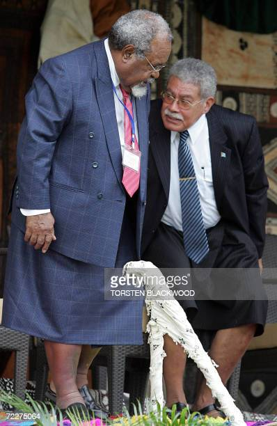 Papua New Guinean Prime Minister Michael Somare talks to Fijian Prime Minister Laisenia Qarase during the opening ceremony for the 37th Pacific...