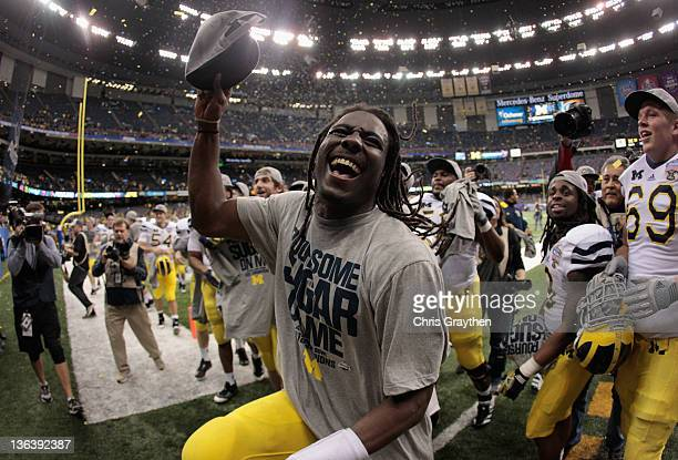 Denard Robinson of the Michigan Wolverines celebrates after Michigan won 2320 in overtime against the Virginia Tech Hokies during the Allstate Sugar...