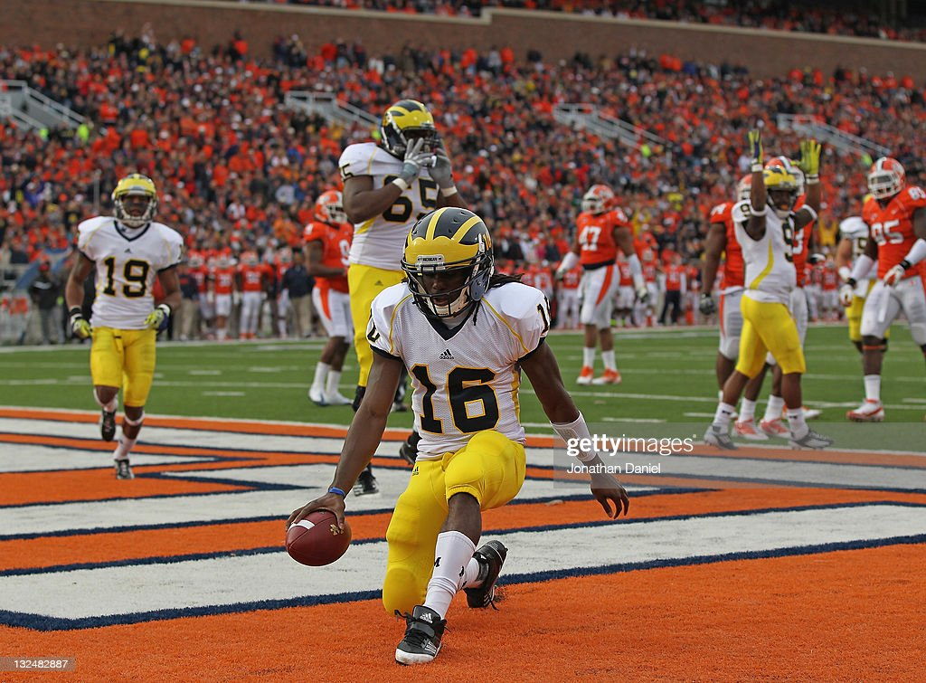 Denard Robinson #16 of the Michigan Wolverines scores his first touchdown against the Illinois Fighting Illini at Memorial Stadium on November 12, 2011 in Champaign, Illinois.