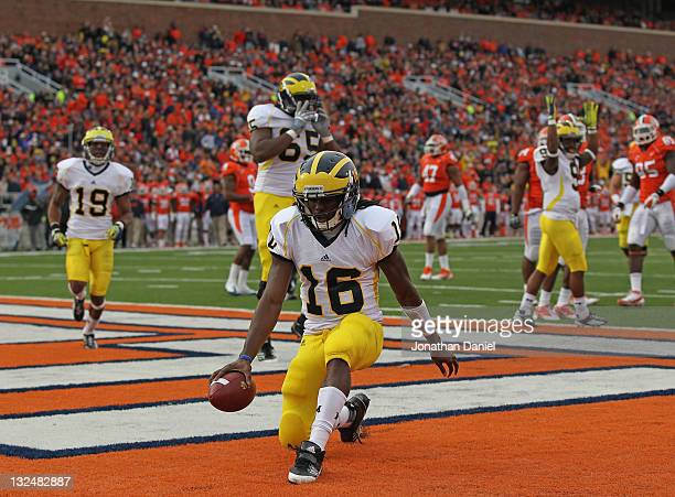 Denard Robinson of the Michigan Wolverines scores his first touchdown against the Illinois Fighting Illini at Memorial Stadium on November 12, 2011...