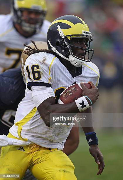Denard Robinson of the Michigan Wolverines takes off on an 87 yard touchdown run against the Notre Dame Fighting Irish at Notre Dame Stadium on...