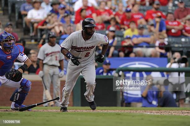 Denard Span of the Minnesota Twins bats and runs to first base from the batter's box in the game against the Texas Rangers at Rangers Ballpark on...