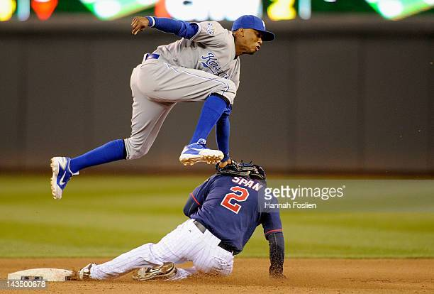 Denard Span of the Minnesota Twins is caught stealing second base by Alcides Escobar of the Kansas City Royals during the fourth inning on April 27...
