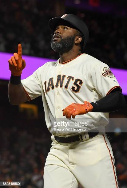 Denard Span of the San Francisco Giants celebrates after he hit a solo home run against the Cincinnati Reds in the bottom of the fifth inning at ATT...