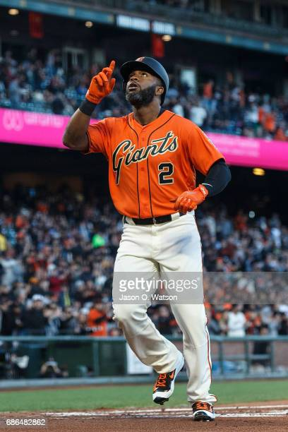 Denard Span of the San Francisco Giants celebrates after hitting a home run against the Cincinnati Reds during the first inning at ATT Park on May 12...