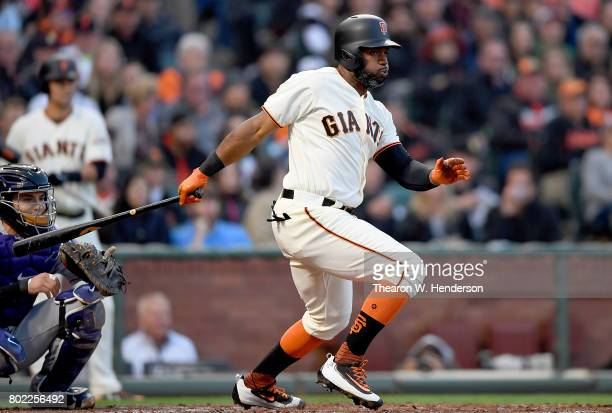 Denard Span of the San Francisco Giants hits an rbi single scoring Gorkys Hernandez against the Colorado Rockies in the bottom of the third inning at...