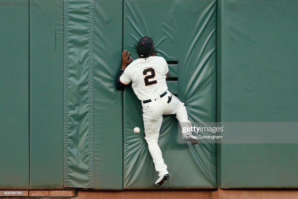 Denard Span #2 of the San Francisco Giants is unable to catch a fly ball hit by Matt Chapman #26 of the Oakland Athletics in the second inning of an interleague game at AT&T Park on August 2, 2017 in San Francisco, California.