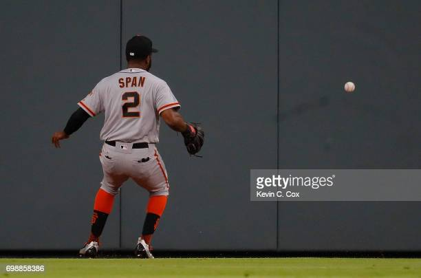 Denard Span of the San Francisco Giants looks to make a play on a RBI triple hit by Johan Camargo of the Atlanta Braves in the third inning at...