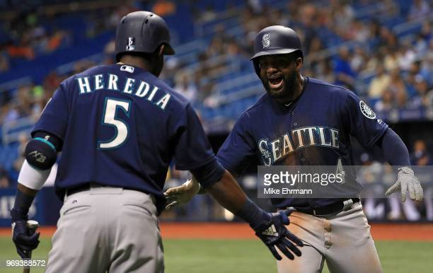 Denard Span of the Seattle Mariners celebrates a home run in the third inning with Guillermo Heredia during a game against the Tampa Bay Rays at...