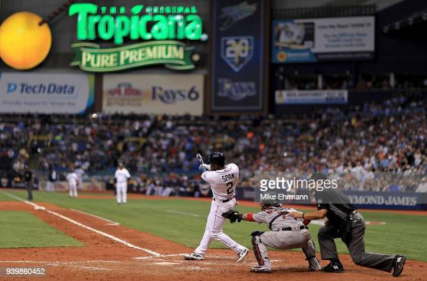 Denard Span of the Tampa Bay Rays hits a three run triple in the eighth inning during a game against the Boston Red Sox on Opening Day at Tropicana...