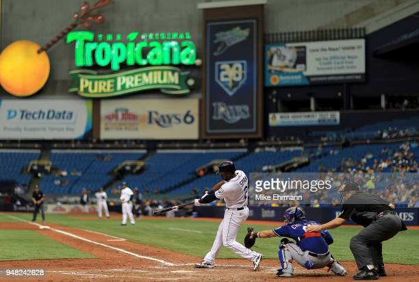 Denard Span of the Tampa Bay Rays hits an RBI double in the eighth inning during a game against the Texas Rangers at Tropicana Field on April 18 2018...