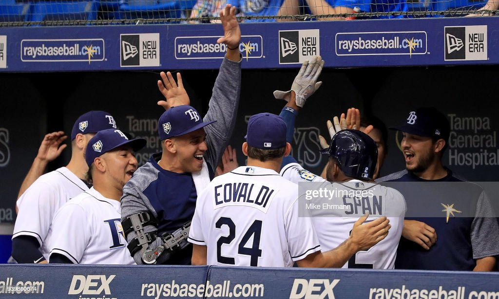 Denard Span #2 of the Tampa Bay Rays is congratulated after hitting a three run triple in the eighth inning during a game against the Boston Red Sox on Opening Day at Tropicana Field on March 29, 2018 in St Petersburg, Florida.