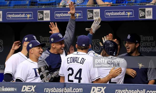 Denard Span of the Tampa Bay Rays is congratulated after hitting a three run triple in the eighth inning during a game against the Boston Red Sox on...