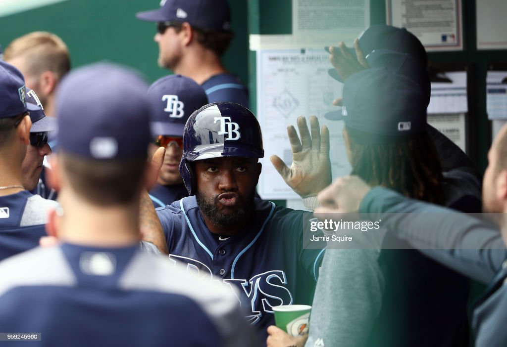 Denard Span #2 of the Tampa Bay Rays is congratulated by teammates in the dugout after scoring during the 1st inning of the game against the Kansas City Royals at Kauffman Stadium on May 16, 2018 in Kansas City, Missouri.