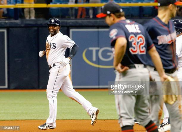 Denard Span of the Tampa Bay Rays jogs between first and second base as he awaits a review of himself beating out a throw to first base where Zach...