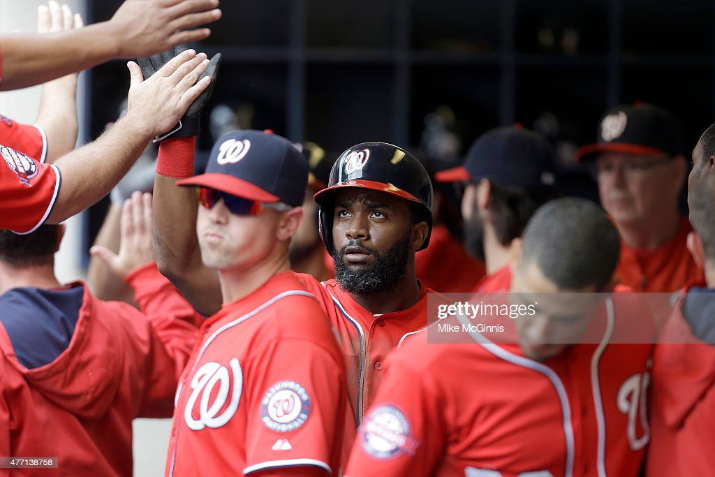 Denard Span #2 of the Washington Nationals celebrates in the dugout after reaching on a sacrifice fly hit by Anthony Rendon during the third inning against the Milwaukee Brewers at Miller Park on June 14, 2015 in Milwaukee, Wisconsin.