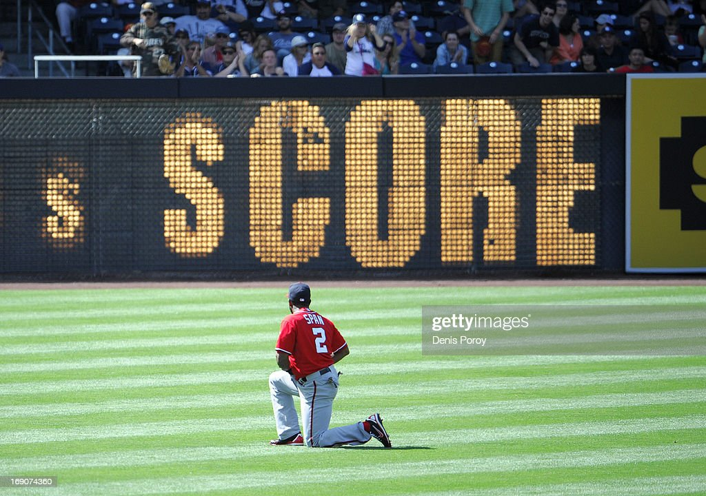 Denard Span #2 of the Washington Nationals goes to his knees after an RBI single hit by Everth Cabrera #2 of the San Diego Padres got past him during the seventh inning of a baseball game at Petco Park on May 19, 2013 in San Diego, California.