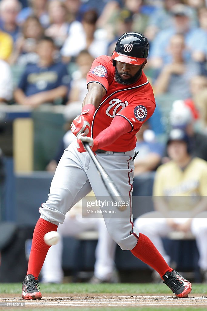Denard Span #2 of the Washington Nationals hits a single in the first inning against the Milwaukee Brewers at Miller Park on June 14, 2015 in Milwaukee, Wisconsin.