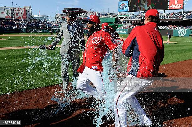 Denard Span of the Washington Nationals is doused with Gatorade by Drew Storen and Tyler Clippard after driving in the game winning run in the ninth...