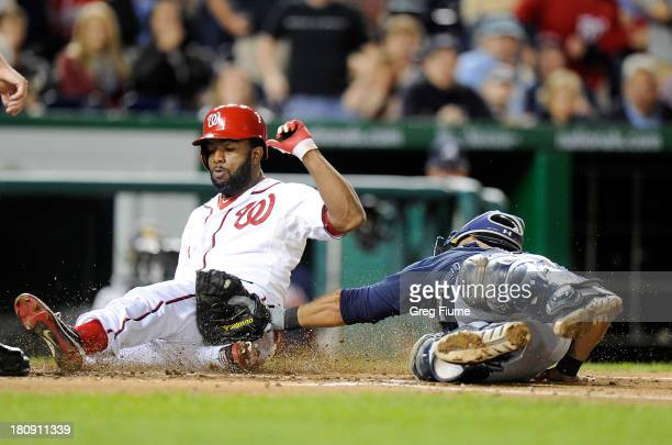 Denard Span of the Washington Nationals is tagged out at home plate in the third inning by Gerald Laird of the Atlanta Braves at Nationals Park on...