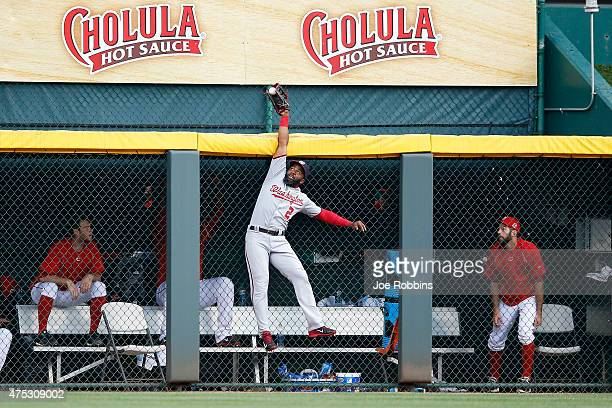 Denard Span of the Washington Nationals is unable to catch a ball hit by Todd Frazier of the Cincinnati Reds in the eighth inning of the game at...