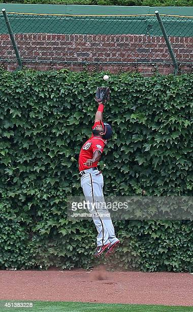 Denard Span of the Washington Nationals leaps to make a catch on a fly ball hit by Justin Ruggiano of the Chicago Cubs in the 4th inning at Wrigley...