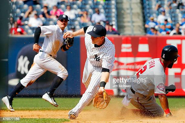 Denard Span of the Washington Nationals steals second base in the ninth inning as Stephen Drew of the New York Yankees recieves the throw at Yankee...