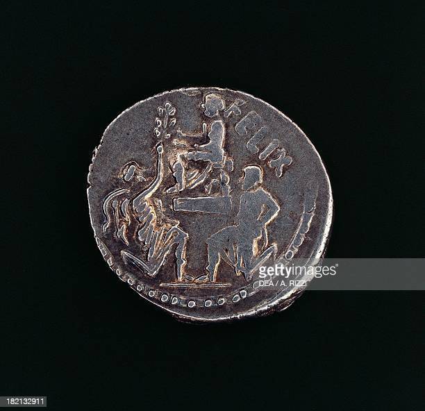 A denarius minted by Sulla's son to honour his father's victory over Jugurtha showing Jugurtha kneeling while Bocchus I bows before Sulla Roman coins...