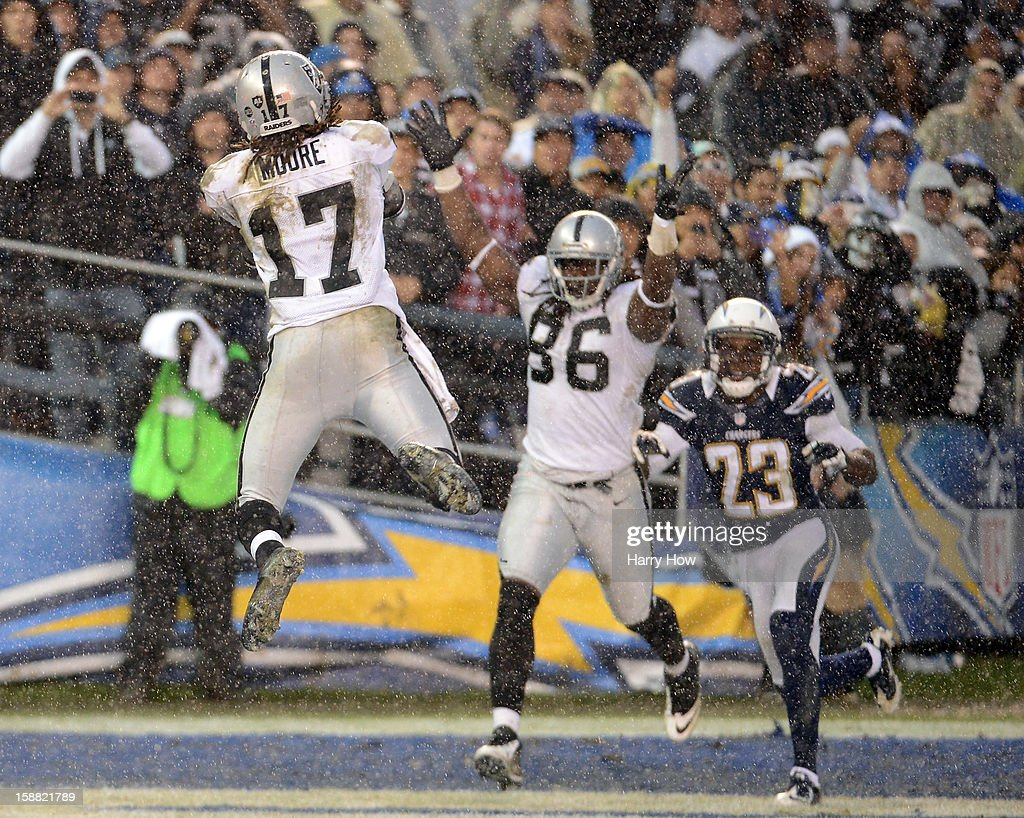 Denarius Moore #17 of the Oakland Raiders makes a catch for a touchdown in front of David Ausberry #86 and Quentin Jammer #23 of the San Diego Chargers during a 24-21 loss to the Chargers at Qualcomm Stadium on December 30, 2012 in San Diego, California.