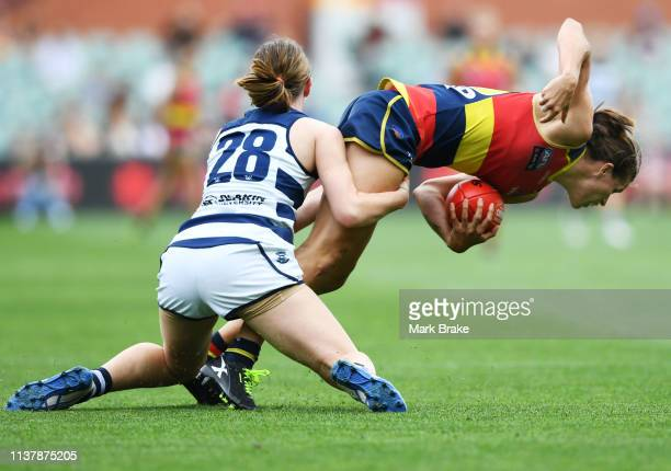 Denby Taylor of the Cats tackles Chelsea Randall of the Adelaide Crows during the AFLW Preliminary Final match between the Adelaide Crows and thew...